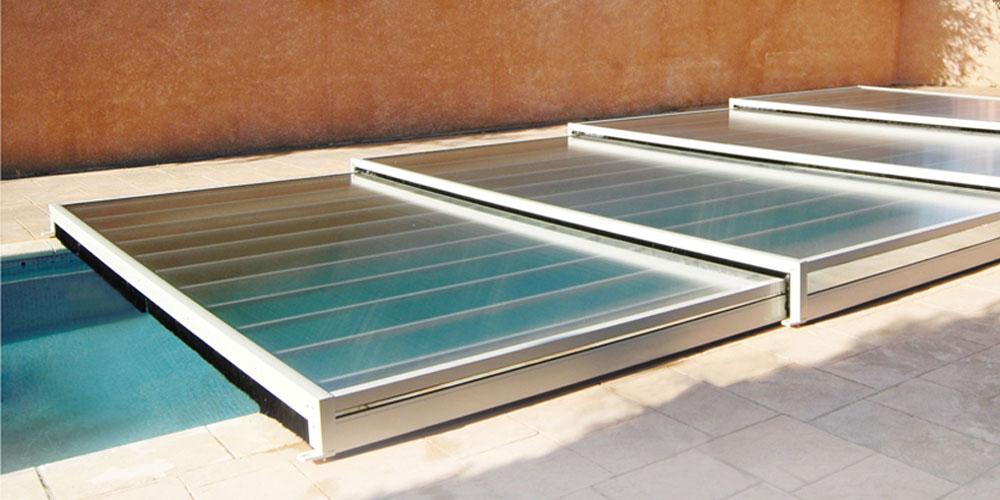 Notre gamme d 39 abris de piscine plats aladdin concept for Aladdin abri piscine